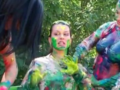 Girls spread body paint on each other outdoors videos