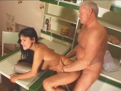 Old man fucks a milf slut on the kitchen counter videos