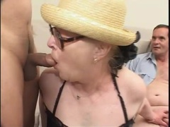 Granny in glasses does a dirty gangbang clip