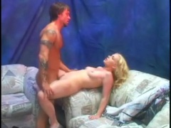 Blonde fucked in the porn warehouse as friends watch videos