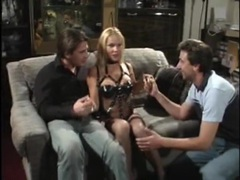 Her leather lingerie is sexy in a threesome fuck video movies at kilogirls.com