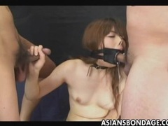 Japanese sucks with a large open mouth gag tubes at lingerie-mania.com