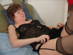 Mature strips from black lingerie to model body movies at lingerie-mania.com