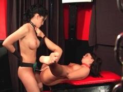 Strapon cock fucks sub girl over a table videos