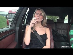 Sexy blonde smokes cigarette in the car videos