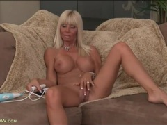 Tanned bimbo milf strips to model her titties videos