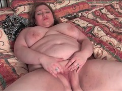 Fat slut on her back masturbating her vagina tubes