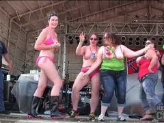 Drunk and chubby party girls dance on stage tubes