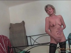 Granny poses in pretty stockings to tease you videos