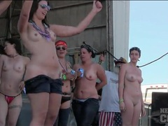 Roadies pour water on topless dancing girls clip