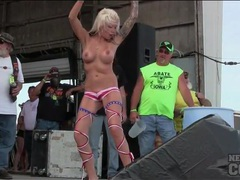 Topless girls dance for biker dudes on stage clip