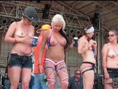 Topless chicks drink and dance outdoors tubes