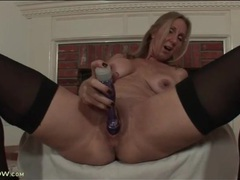 Purple dildo penetrates wet milf pussy movies