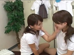 Pigtailed japanese teens kiss in locker room tubes at lingerie-mania.com