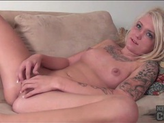 Young tattooed blonde masturbates shaved vagina clip