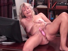 Naked granny on a desk masturbates her cunt movies at sgirls.net
