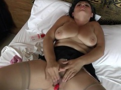 Curvy milf rubs her clitoris with eyes closed tubes