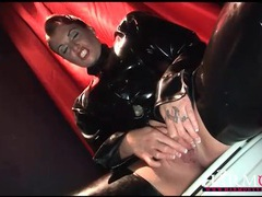 Babe in black latex pisses in the toilet videos