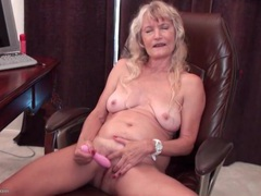 Horny granny masturbates in home office videos