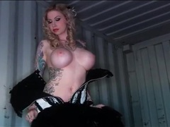 Heavily tattooed hottie strips off her sexy corset videos