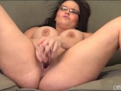 Thick babe in glasses fucks a dildo videos