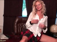 Milf in sexy plaid skirt fondles her tits videos