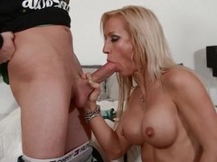 Mom with sexy implants gives a hot blowjob videos