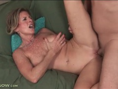 Freckled mom with sexy implants rides a cock videos