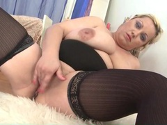 Fatty in black stockings rubs her bald pussy movies at sgirls.net
