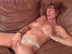 Milf redhead in lace lingerie plays with her tits videos