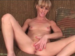 Skinny mature blonde strips and plays solo videos