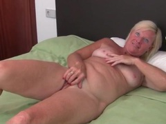 Freckled mature alone in bed and masturbating videos