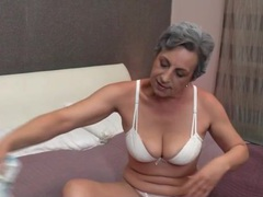 Granny strips to her white panties in bed videos