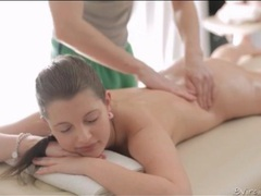 Teenage beauty on her stomach for a massage movies at freekilomovies.com