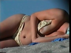 Tits come out of her bikini on the beach videos
