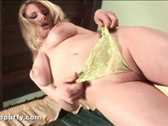 Cute curvy blonde in yellow panties plays videos