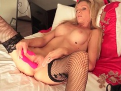 Naked milf with a perfect body fucks a toy videos