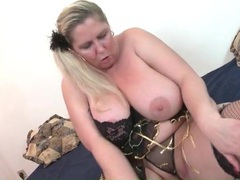 Blonde bbw looks sexy in black fishnets videos