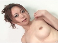 Japanese girl pours thick cream on her body tubes at japanese.sgirls.net