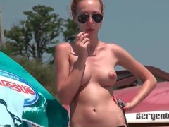 Topless perky tits girl smokes on the beach tubes