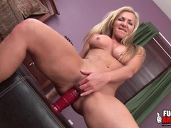 Milf sits on a big dildo and stretches her hole videos