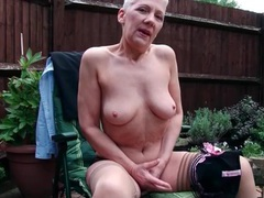 Old lady teases in sheer panties outdoors movies at lingerie-mania.com