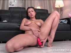 Curvy girl fucking a toy and pissing videos