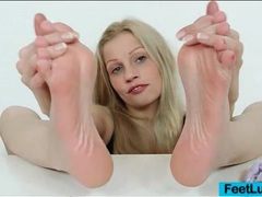 Sexy girl rubs lotion into her gorgeous feet videos