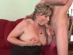 Mature in a beautiful dress sucks cock videos