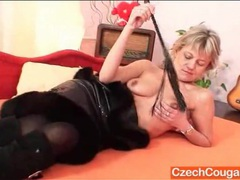 Dominant mature in a leather dress and boots videos