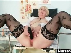 Stripping nurse opens her pussy to show it off tubes
