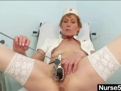 Slender mature nurse fucks cunt with a black toy movies at kilopics.com