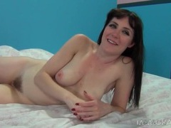 Blue eyed brunette beauty masturbates and chats clip