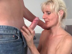 Kissing with a busty mature babe makes him hard movies at freekilomovies.com